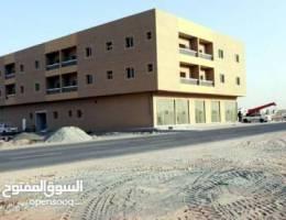 بنايه بالجرف عجمان ارضى و2 على شارعين قار وسكه جديده اول ساكن ( كهرباء- ماء)