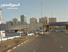 ارض 10 الاف قدم تجارية علي زاويه شارع الشيخ خليفة وشارع السفير ميني مول وجسر غلفا